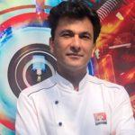 "A book titled ""Kitchens of Gratitude"" authored by Chef Vikas Khanna"