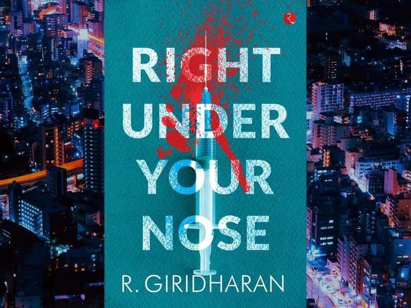 RBI officer Giridharan pens novel 'Right Under our Nose'_40.1